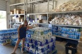 SOS Radio Stocks Serving our Kids Foundation with Enough Bottled Water for Summer!